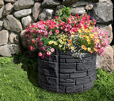 Sierra Stone self watering planter round at a location